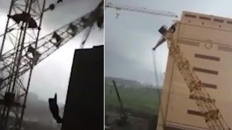 """""""По-любому живой!"""": рабочие сняли, как ураган повалил краны в Тюмени"""
